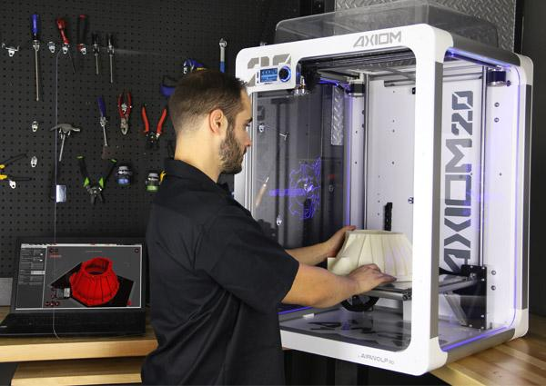 the man prints on the Airwolf3D AXIOM 20 Large Format 3D Printer