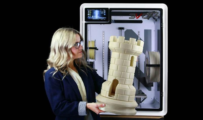 the woman prints on the EVO 22 Large 3D Printer/Additive Manufacturing Center