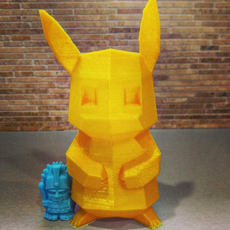 low-poly Pikachu model. Despite the visible layers, it looks precise and shows a decent print quality