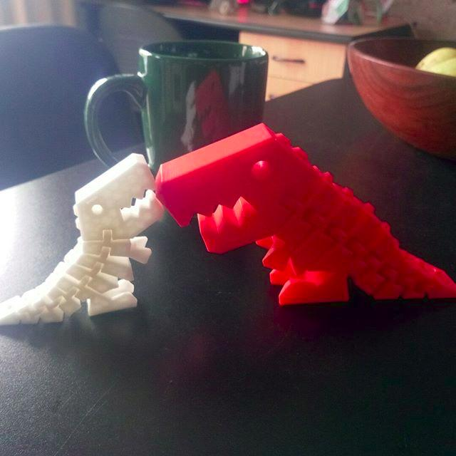 white and red dinosaurs made of PLA