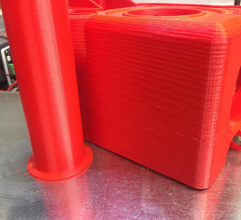 a some red model printed in the FLSUN 3D i3 Plus Large Print Area 3D Printer Kit