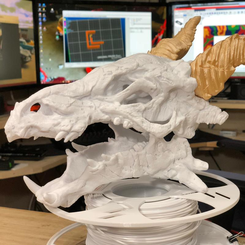 Dragon skull at 0.1mm layer height. It took 94 hours of printing for the Skull and 25 hours for the horns. It all worth the time.