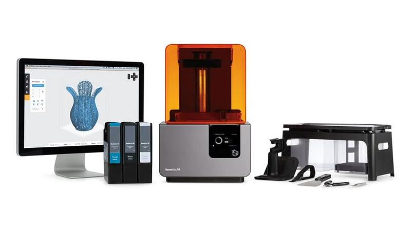 the formlabs form 2 3d printer with a computer and printing cartriges