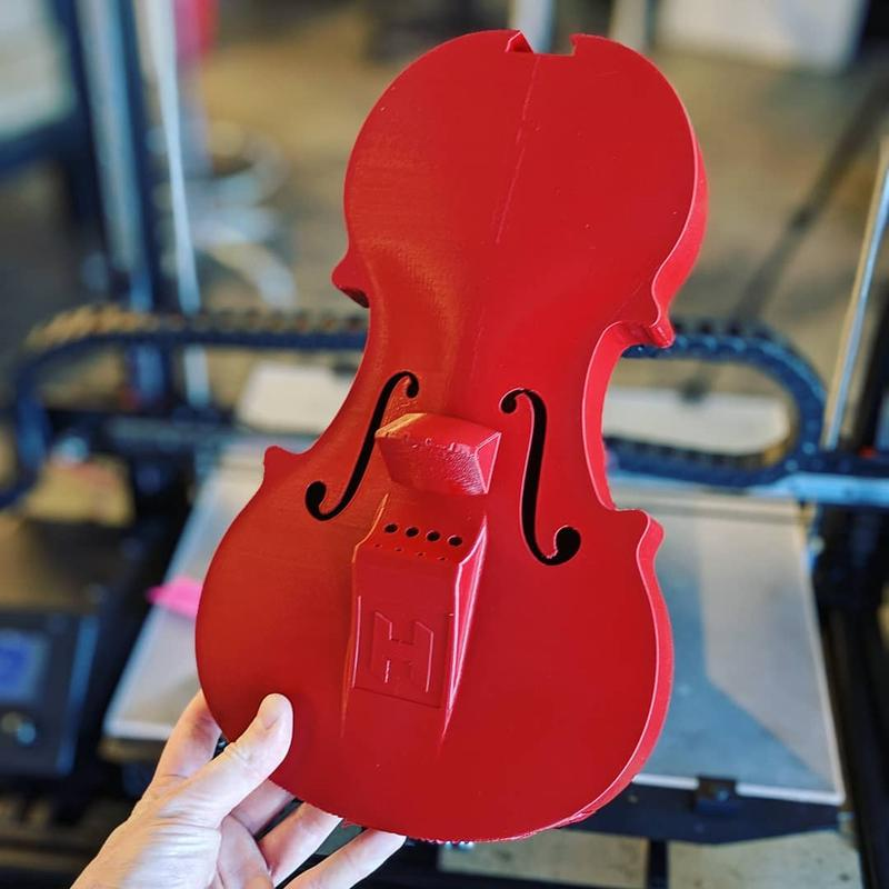 Look at this good-looking violin. It has smooth surfaces and neat edges.