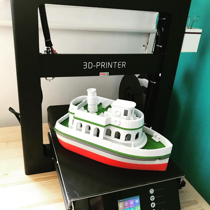 a multicolored, large boat. That's a great printing result.