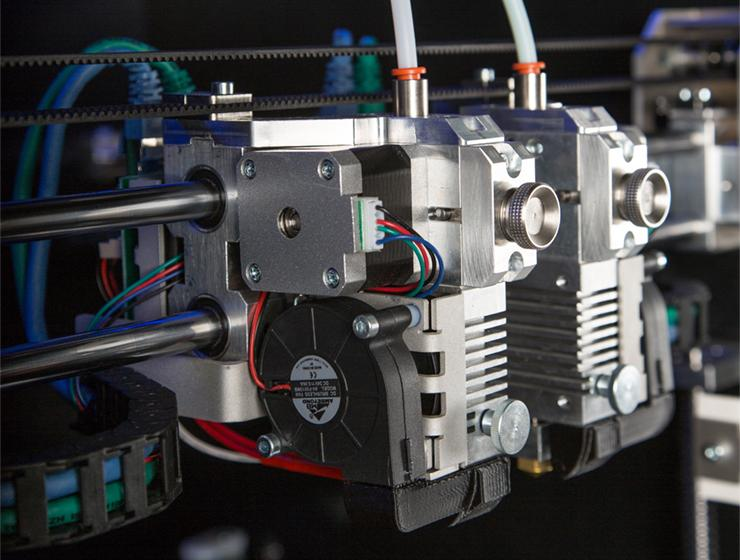 The print head runs on rods with linear bearings