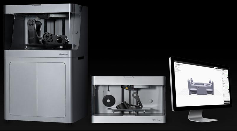 the Markforged X7 3D printer with a notebook