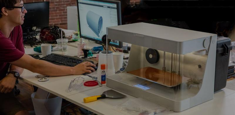 a man prints on the Markforged Onyx One 3D printer