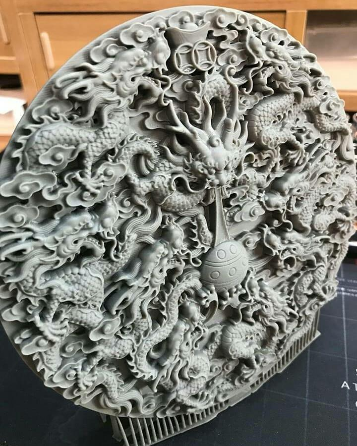 This intricate dragon plate shows accurate, minute details within a large volume, highlighting the industrial quality of the print.