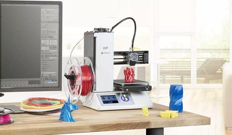 Monoprice Maker Select Mini v2 3D Printer with filaament on the table