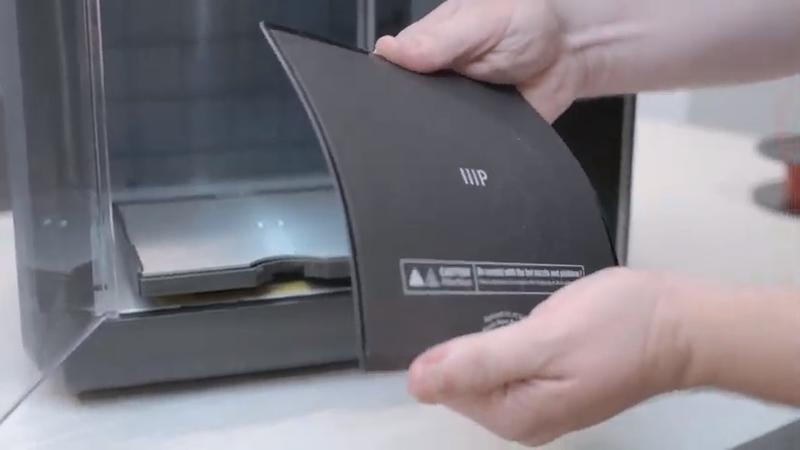Slide off and flex the plate to quickly remove your prints.