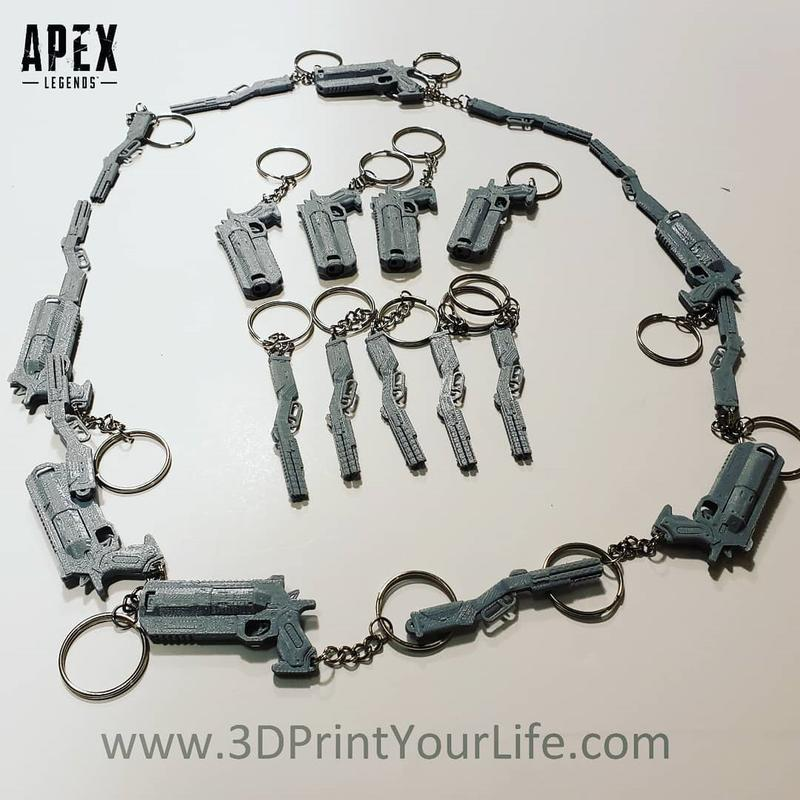 keychains as the Wingman and Peacekeeper guns from the Apex Legends video game.