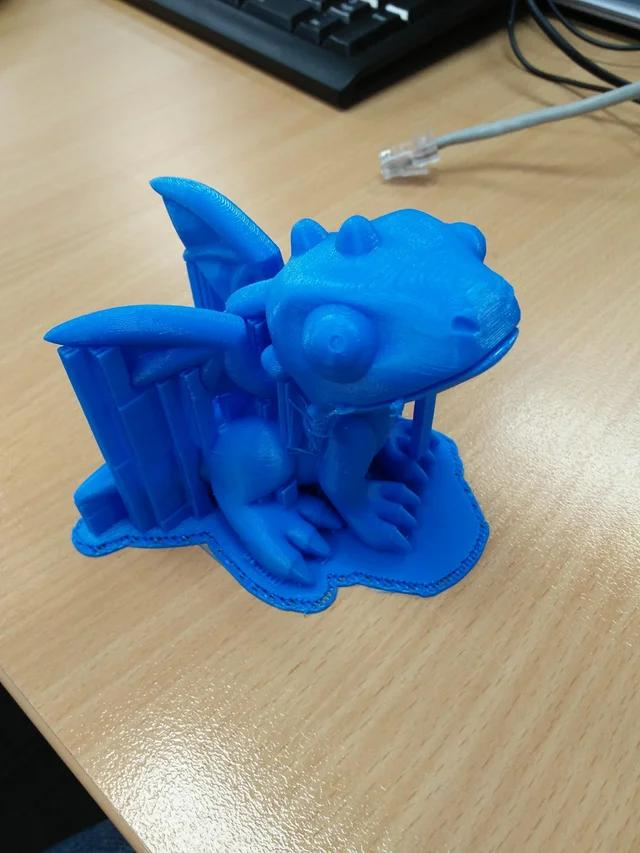The PowerSpec i3 Mini is an FDM 3D printer that can print layers at 100 microns blue dragon