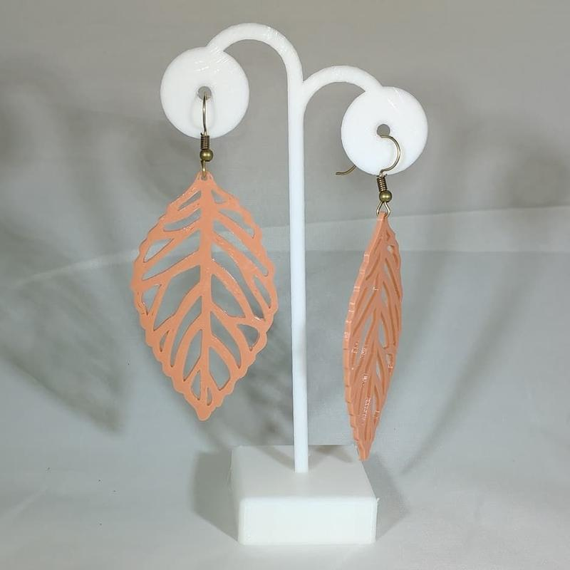 custom earrings with their own stand. Look how nice and rich in details they are.