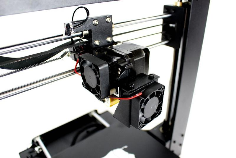 The extruder comes with a fan for printing with PLA-type materials. The fan cools the model down dealing with stringing and warping.
