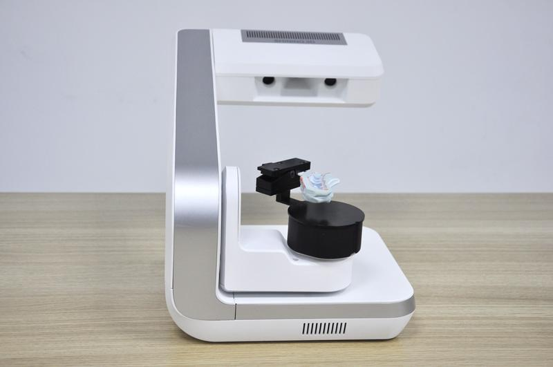 the Shining 3D AutoScan-DS-EX 3D scanner on the table