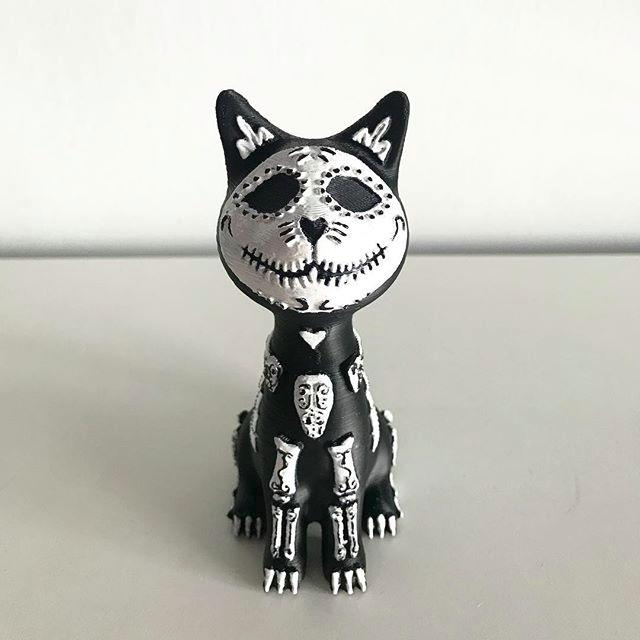 The Mexican sugar skull cat