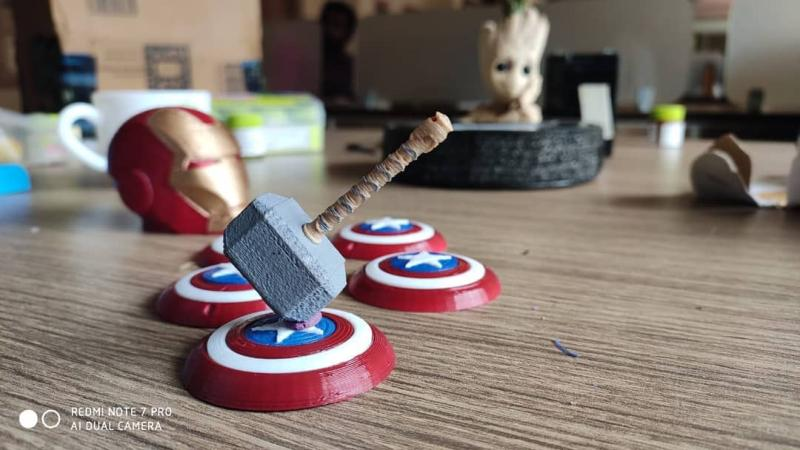Captain America's shield, Thor's hammer, Iron Man's mask and Groot